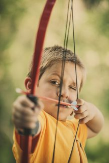 Participating in archery practice